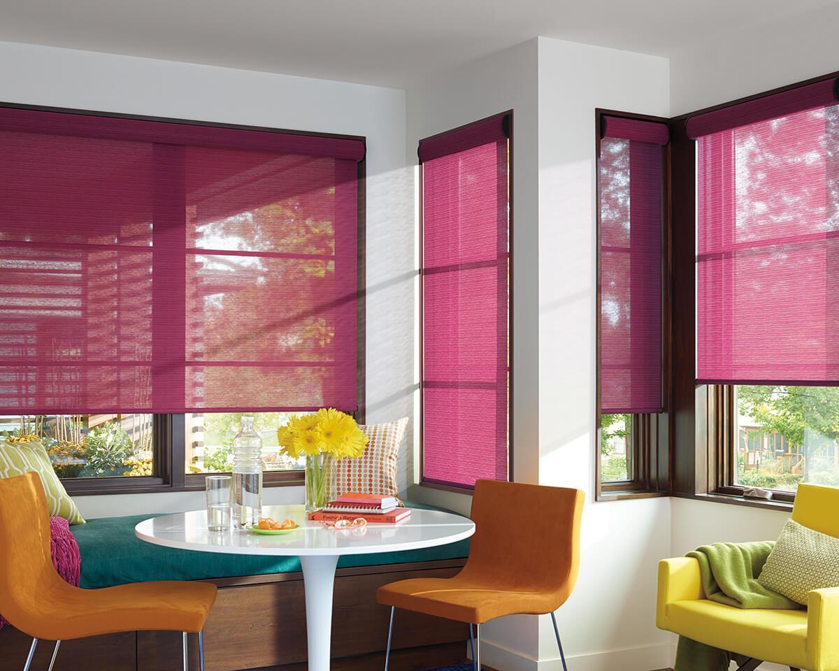 designer roller shades in dining room