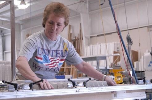 Woman making plantation shutters